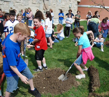 Planting trees on Arbor Day.