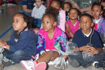 "Children enjoying the ""Trees, Who Needs 'Em"" program."