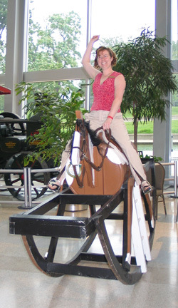 Alissa Madden of Northside Animal Hospital takes a moment to enjoy a giant rocking horse during Scales & Tails 2008.