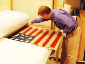 Dale Ogden, Indiana State Museum Chief Curator, with Ford's Theatre flag