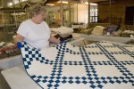 Kathleen McLary judges antique quilt at In. State Fair
