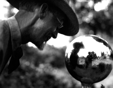 T.C. Steele eyeballs the gazing ball. A close look reveals the photographer, Frank Hohenberger.
