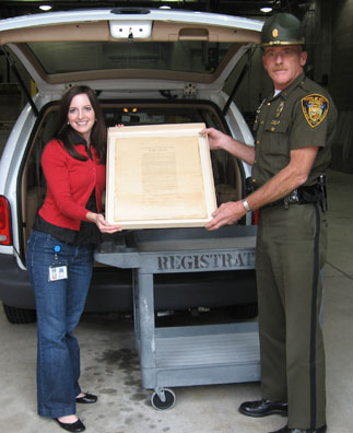 Collections assistant Meredith McGovern and Lieutenant Dean Jenkins with the Emancipation Proclamation.