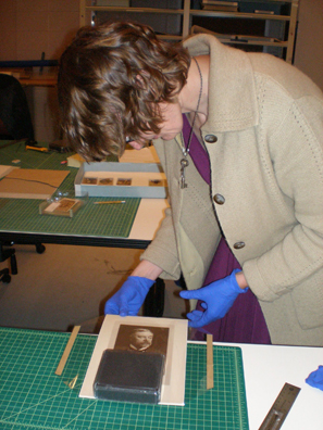 Conservator Gaby Kienitz works with items from the LFFC.