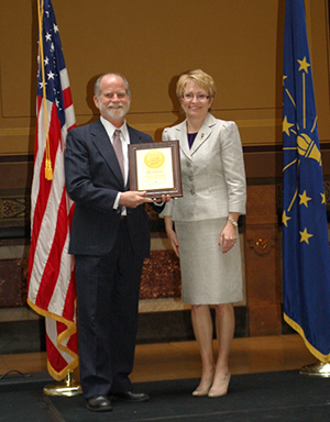 Bill Lackner  receives his Hoosier Hospitality Award from Sue Ellspermann at the ceremony on May 8 at the Indiana Statehouse.